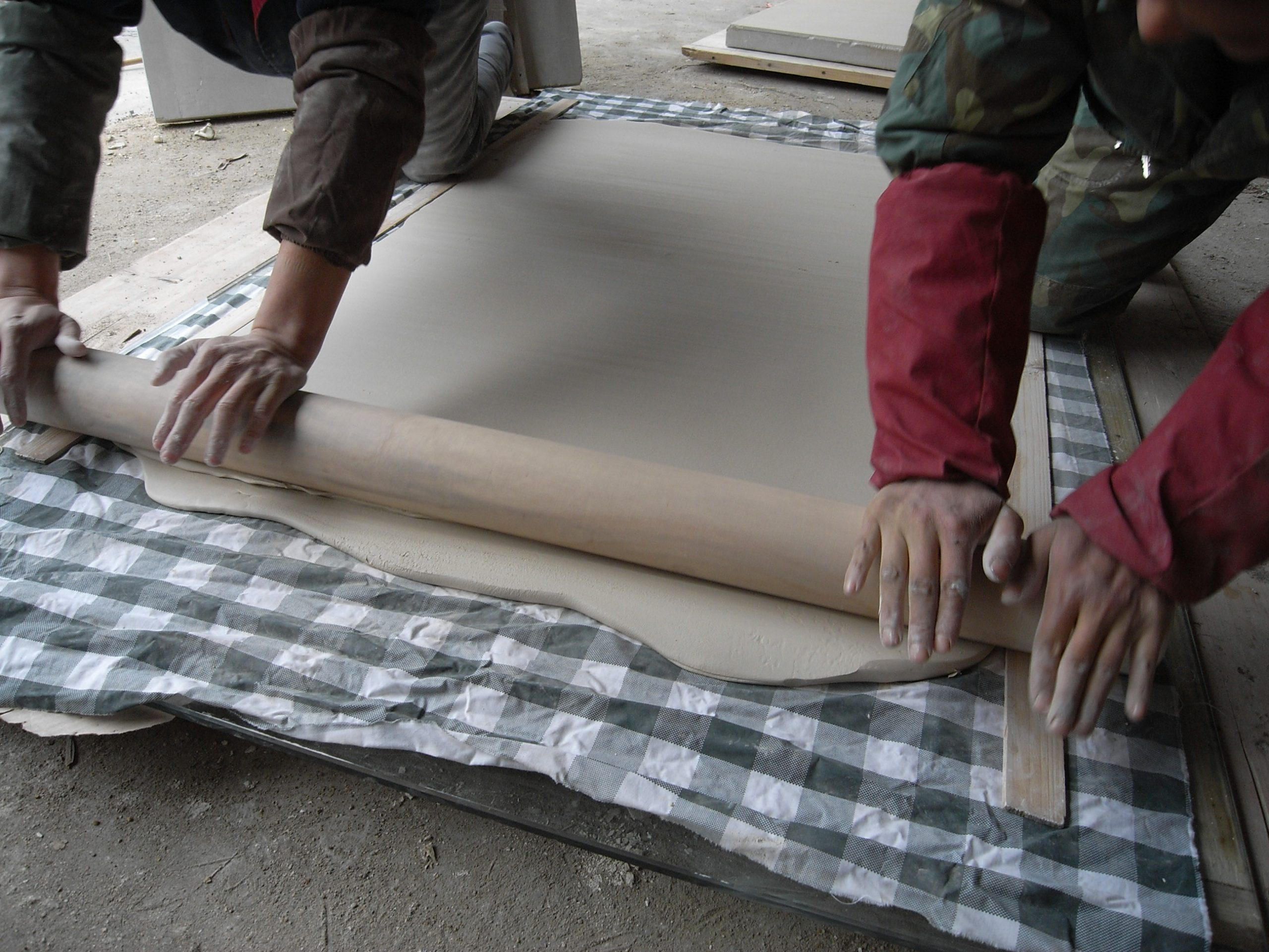 Studio assistants rolling out clay in Lin Jianhua's studio. Photo courtesy of the artist.