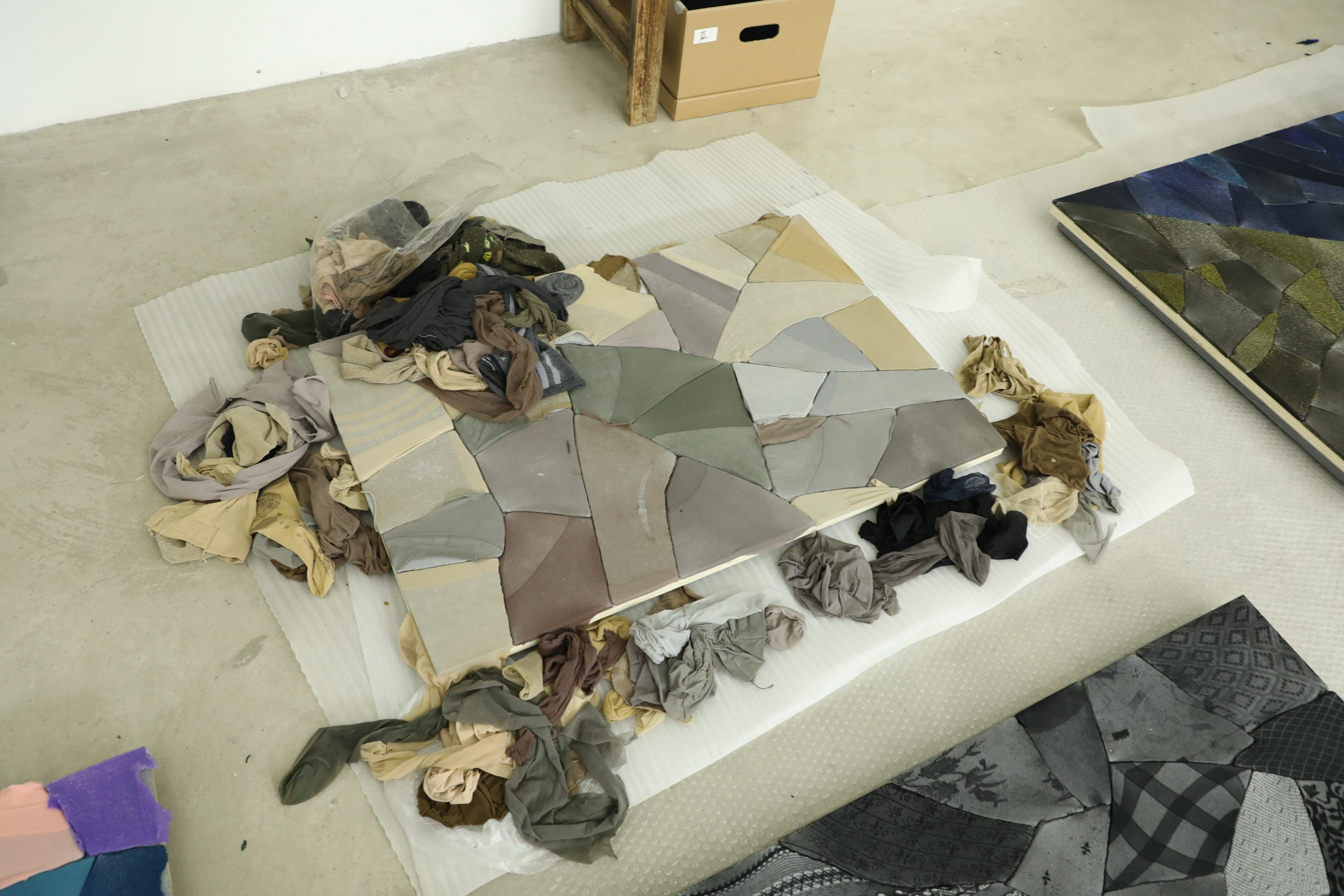 Assorted nylon stockings and a work in progress in Ma Qiusha's studio. Photo commissioned by the Smart Museum of Art during an artist interview. Photo by Yaya Rotem.