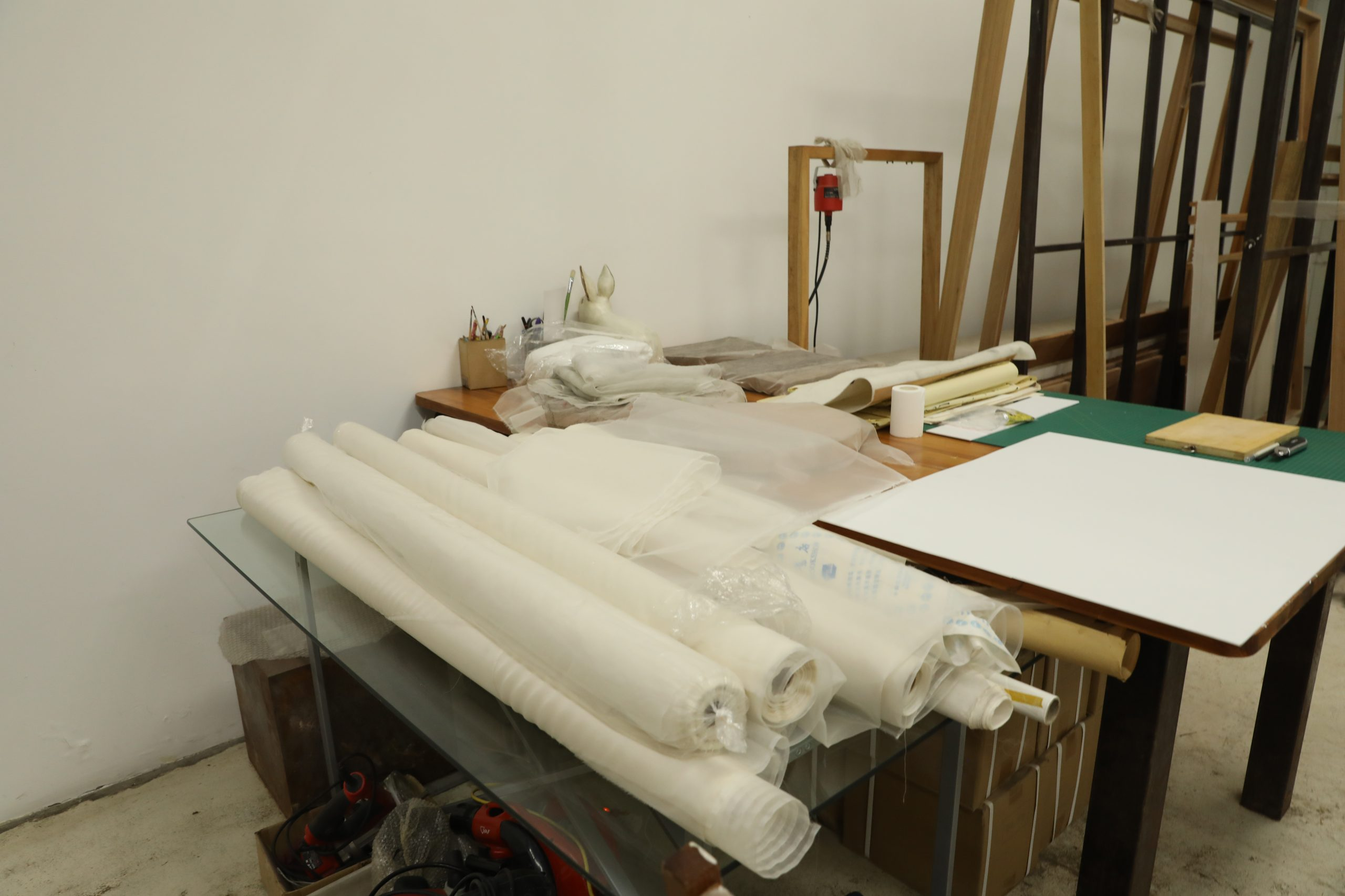 Rolls of silk in Hu Xiaoyuan's studio. Photo commissioned by the Smart Museum of Art during an artist interview. Photo by Yaya Rotem.