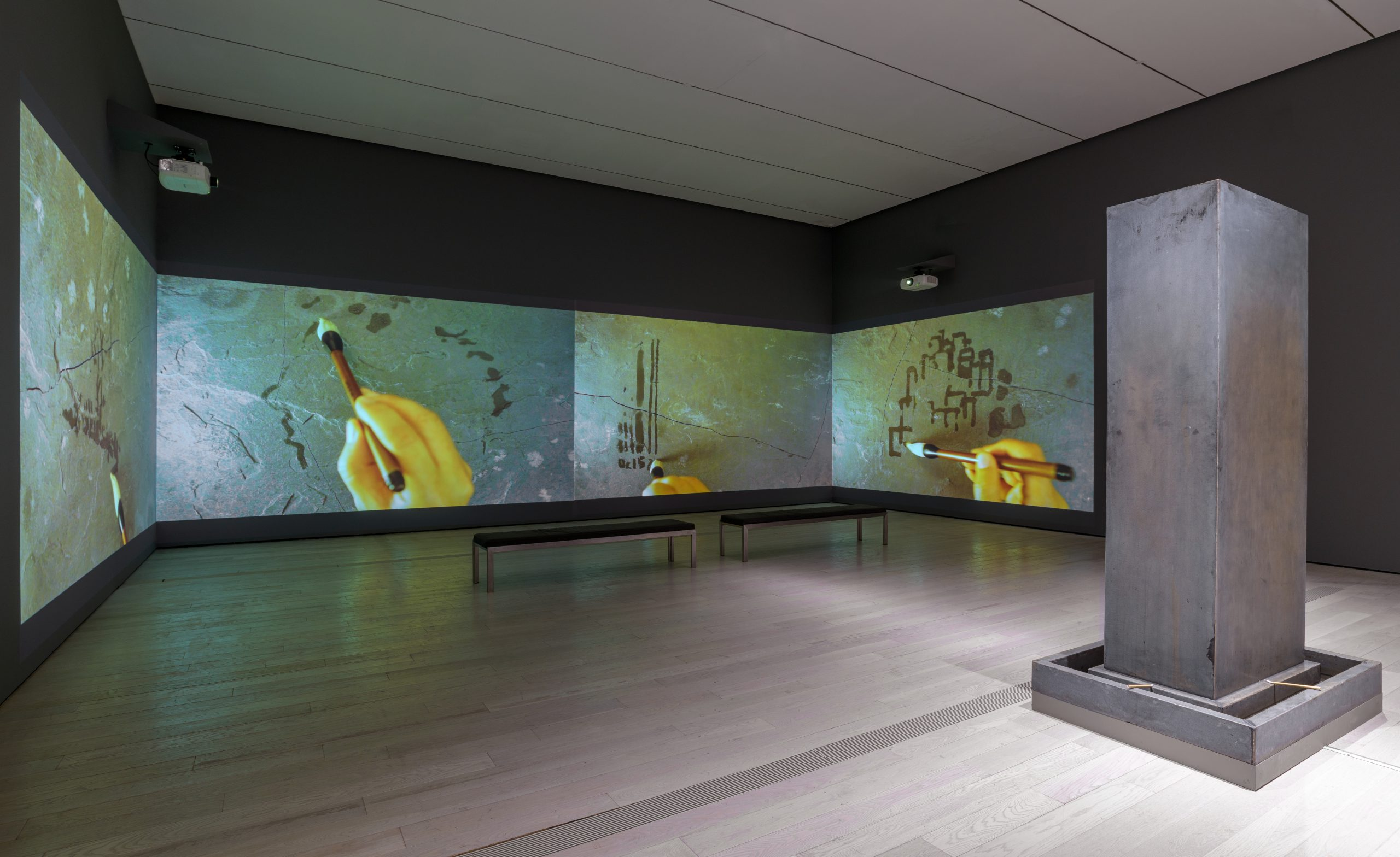 Song Dong, Water Records, 2010, Four-channel video projection; and Traceless Stele, 2016, Metal stele, water, brushes, and heating device. Collection of the artist, courtesy of Pace Gallery. Installation view at the Los Angeles County Museum of Art. Photo: © Museum Associates/LACMA.