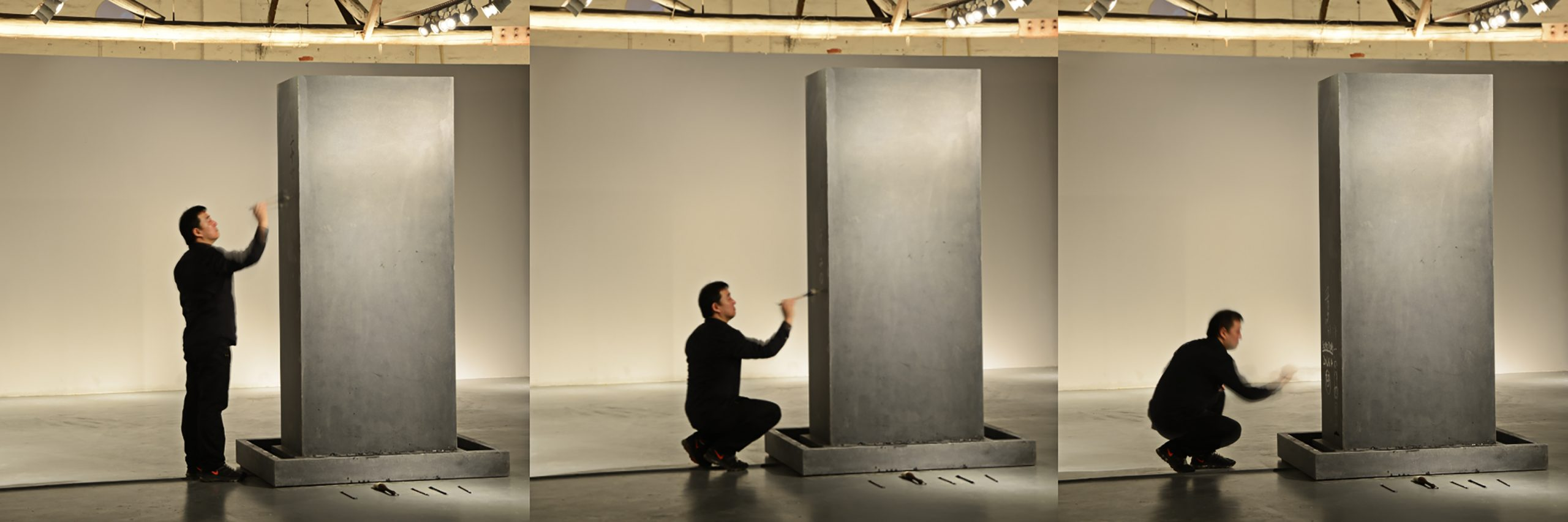 Song Dong painting in water on his work Traceless Stele, 2016. Photo ©️ Song Dong
