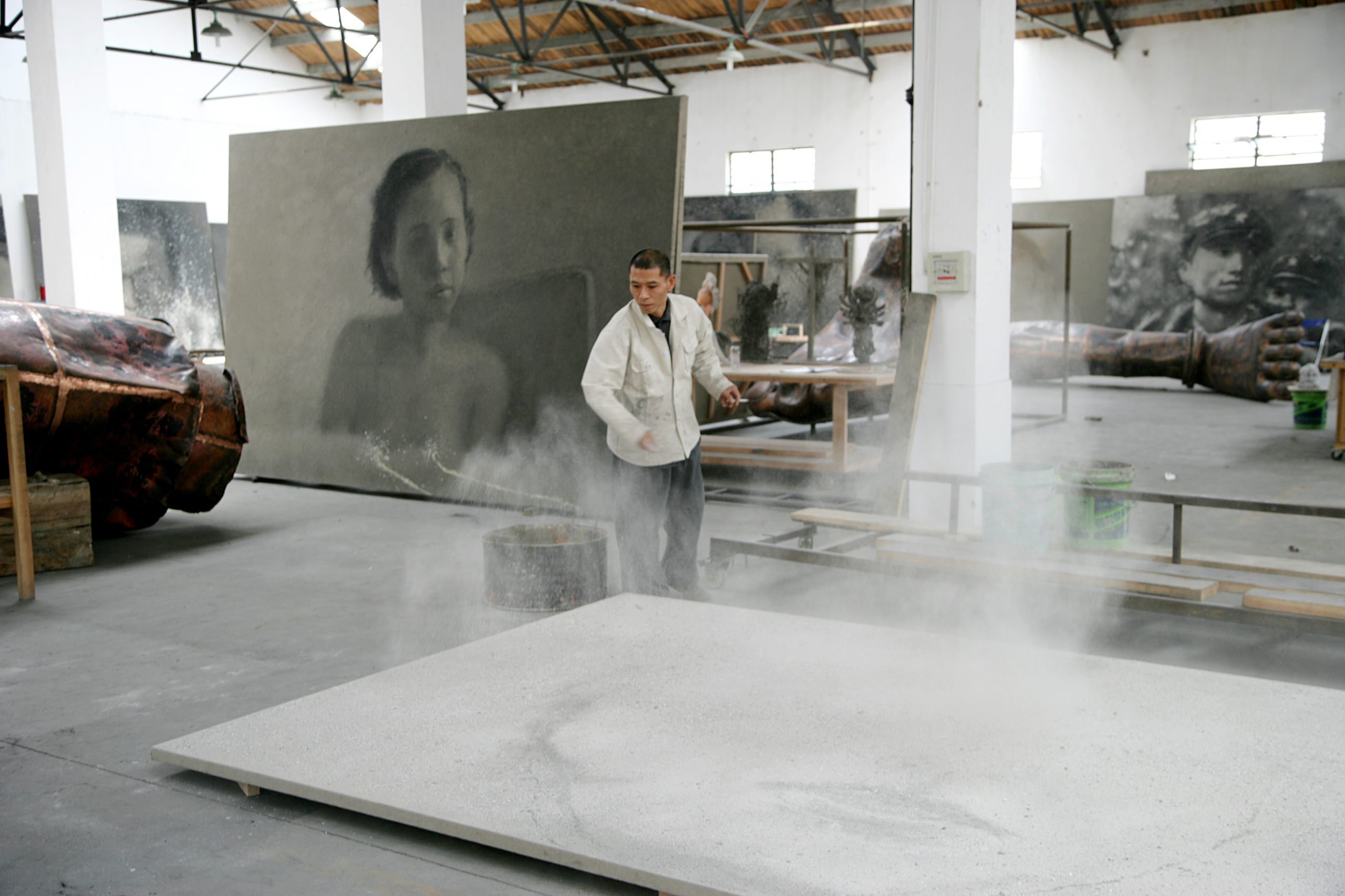 Zhang Huan applying ash to a painting. Photo courtesy of the artist and Pace Gallery.